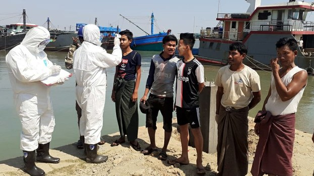 Bangladeshi health workers check Myanmar sailors who arrived at the Teknaf port for COVID-19 symptoms. (N/A, March 18th, 2020) RFA.