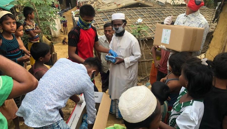Rohingya volunteers distribute masks and supplies in Cox's Bazar, Bangladesh. (Karen Pinchin, March 25th, 2020) Frontline.