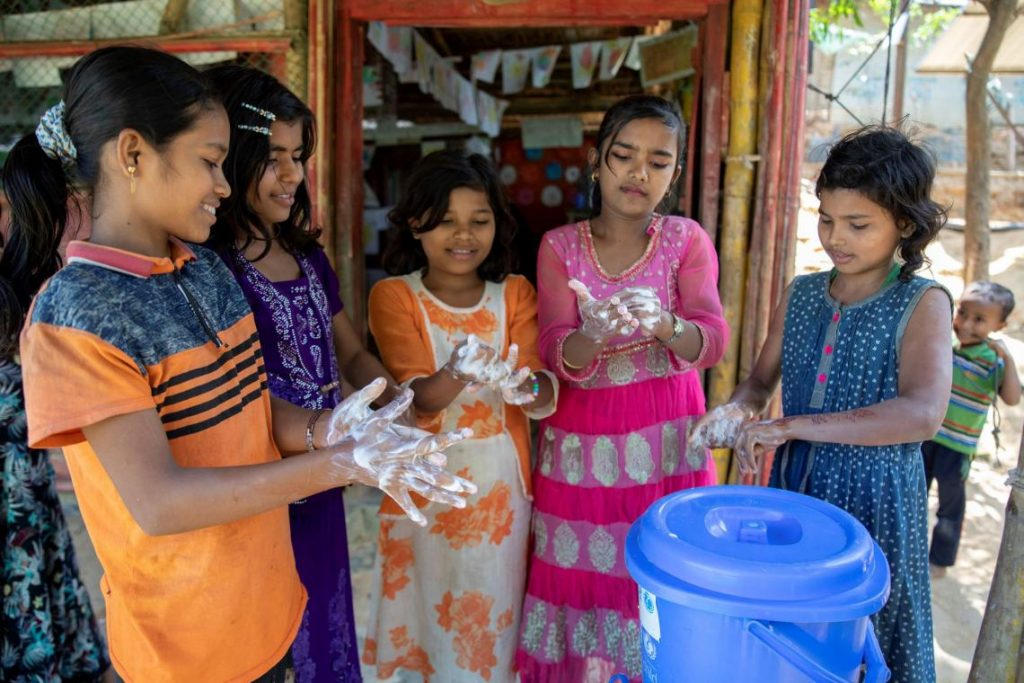 Rohingya refugee children washing their hands. (N/A, March 20th, 2020) Unicef.