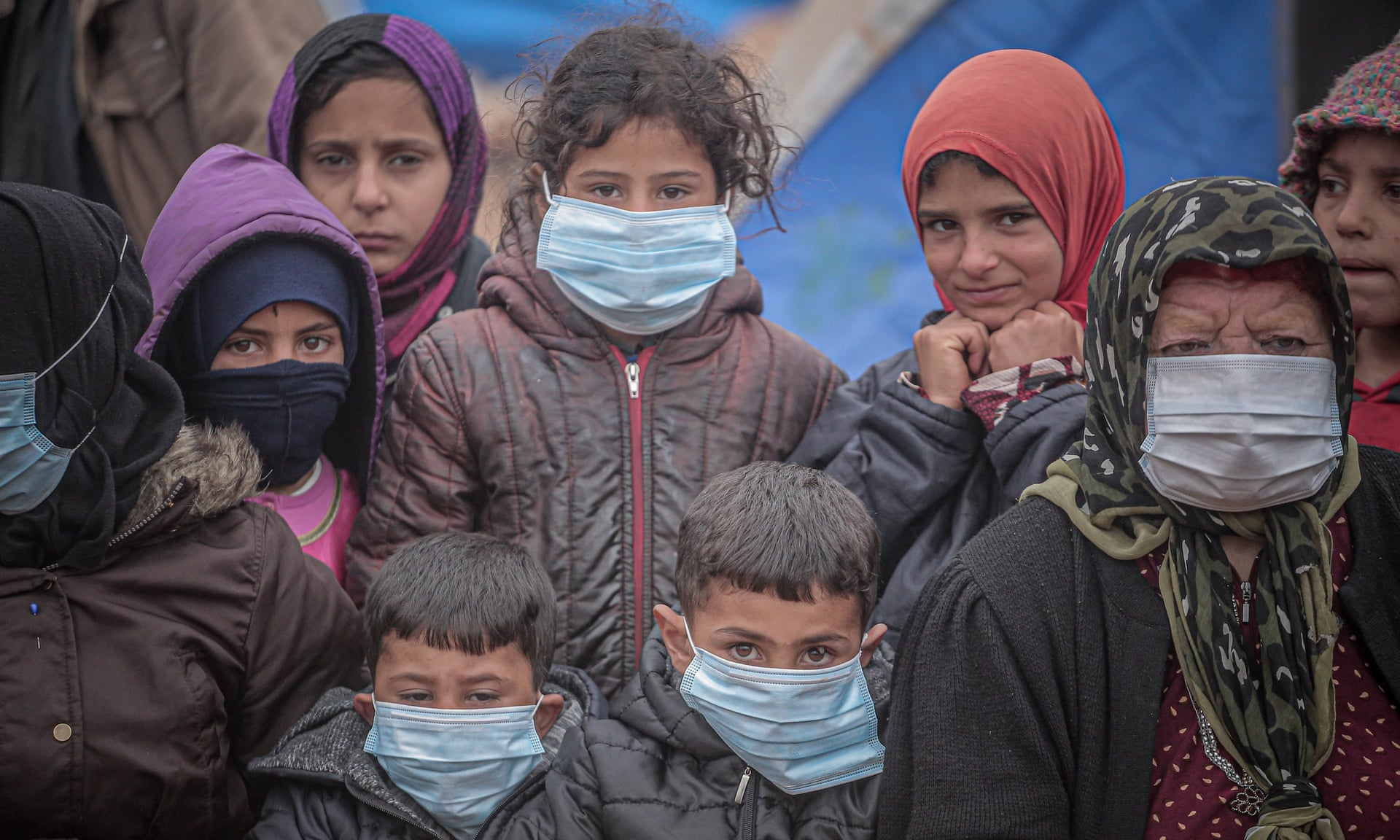 Children and an elderly woman wear masks as a preventive measure against the coronavirus in Idlib. (Muhammed Said, N/A) Anadolu Agency via Getty Images